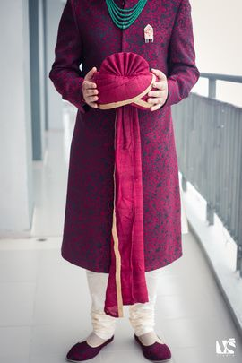 Groom Wear - Hot Pink and Dark Blue Sherwani | WedMeGood Purple and Dark Blue Sherwani with Emerald Necklace and Red Safa  #wedmegood #safa #groom #wear