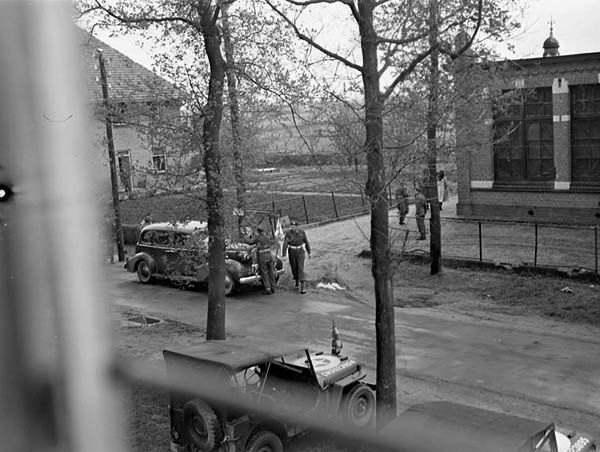 German and Canadian negotiators arrive at a schoolhouse, 30 April 1945. Achterveld, Netherlands. (Photographer: Ernest DeGuire. Library and Archives Canada a154126)