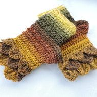 For these autumn coloured crochet adults wrist warmers, fingerless mitts, I've used an acrylic and wool graduated yarn.  Multi tonal autumn colours of mustard, russett, gold, mushroom and olive. Crocodile or Dragon Scales cuffs and a plain body. Warm a...