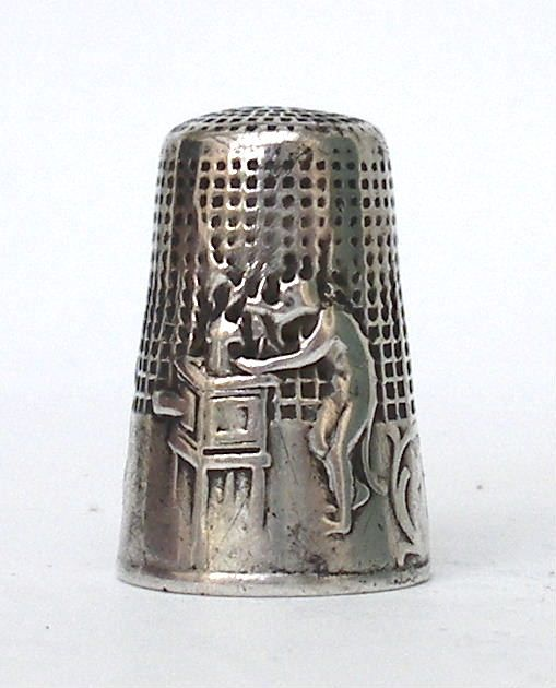 a fable type thimble showing a monkey with a cine projector. A cat, a dog and a turkey are watching the show.
