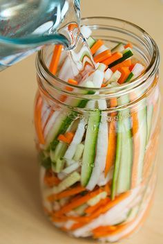 Viet Pickled Vegetables 1/4 lb. cucumber1 lb. daikon,1 lb. carrots, 2 tsps sea salt 1 cup unseasoned rice vinegar 1 cup sugar1 cup water vegetables fairly dry (pat them dry) Combine the vinegar, salt, sugar, and water together until sugar dissolves. Place vegetables in a jar and pour the pickling liquid into the jar so that all of the vegetables are submerged. Store them sealed in the jar in the refrigerator for 5 days for best flavor.