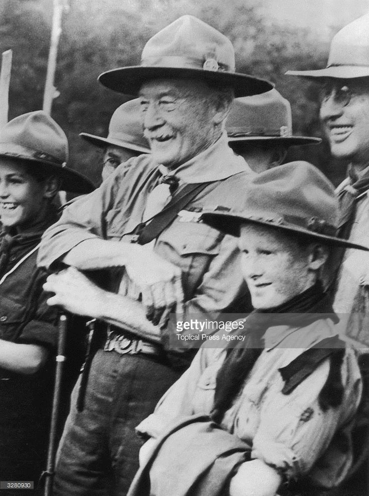 Sir Robert Baden Powell (1857 - 1941), founder of the Boy Scout movement, with his son Peter, highly pleased with the welcome they received from the Scouts of Cape Town.