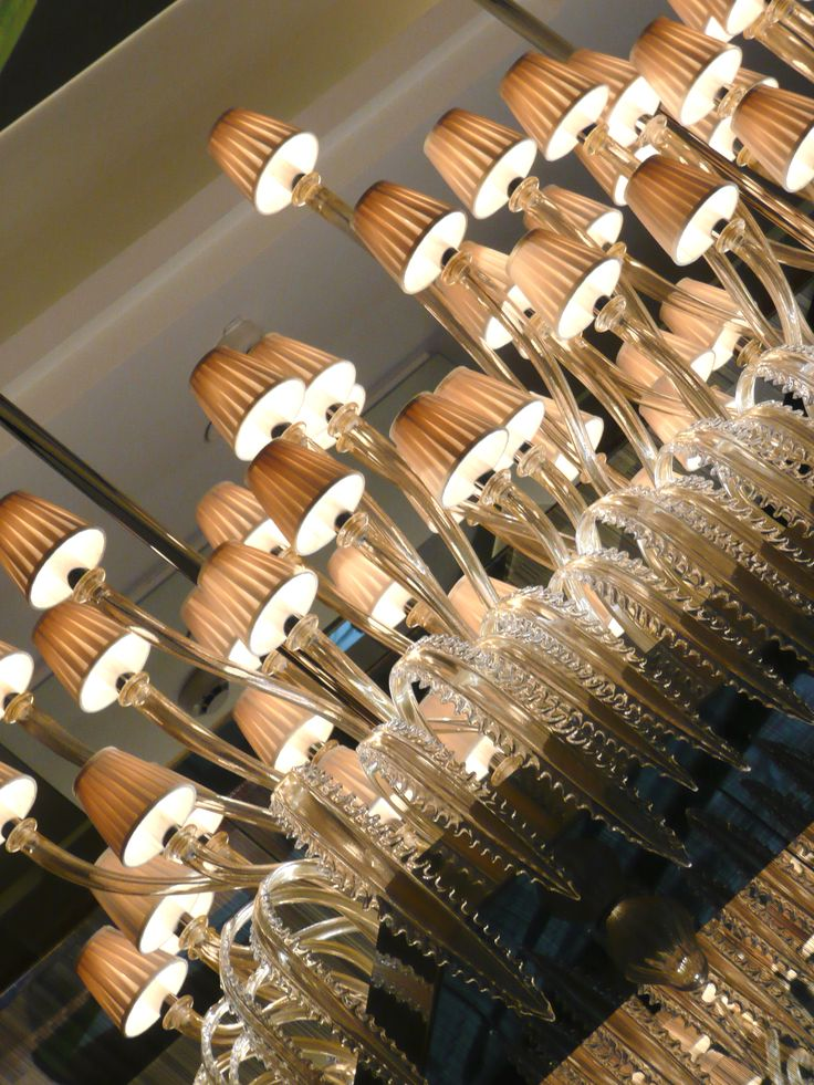 A magnificent #Murano glass #chandelier designed by #BrunoBorrione at Les Heures #bar, #PrincedeGalles #Paris.