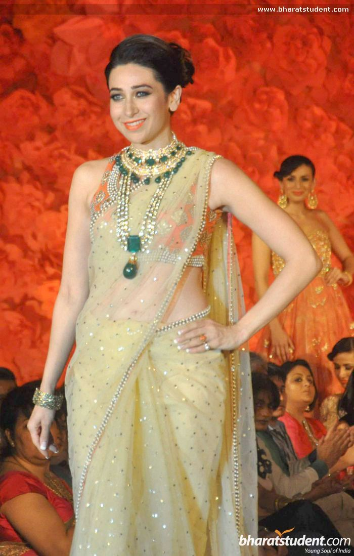 Karisma Kapoor walks for Maheka Mirpuri 2013. Cream and orange sari.