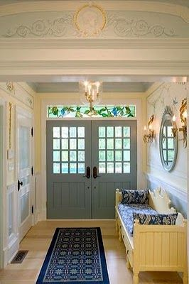 Swedish style entry. The double doors are so inviting, as is the color  palette