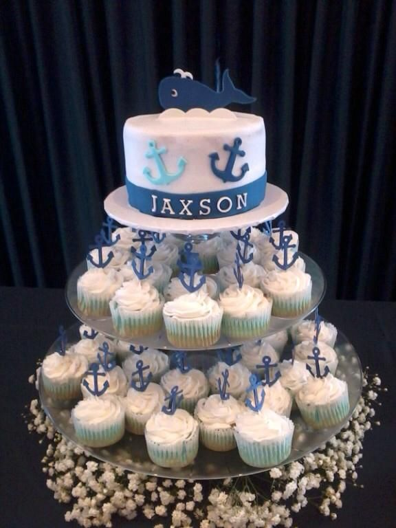 Navy Theme Baby Shower - 6 inch cake with butter cream and mmf accents. 2 dozed cupcakes with butter cream and anchor toppers  http://modernbabyshowerideas.blogspot.com/