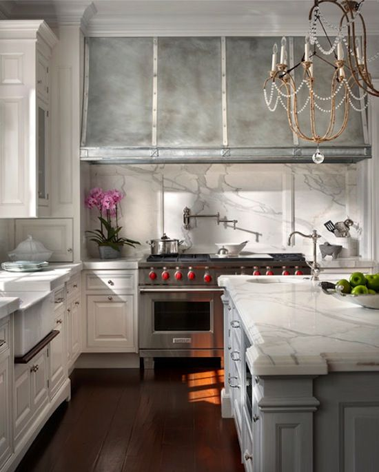 This slab marble is gorgeous (particularly as the back splash with that hood, and love that chandelier: