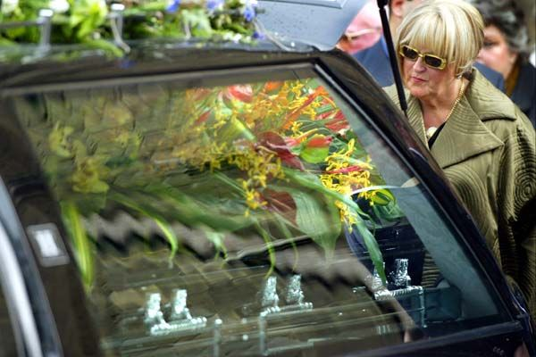 Judy Moran with the casket after the funeral of her son Jason Moran at St Mary's church in West Melbourne, June 30 2003. Photo: Paul Harris