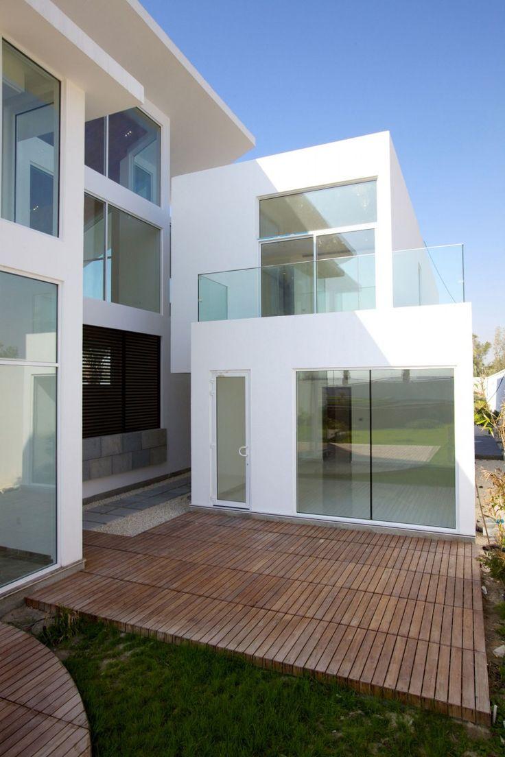 Futuristic home Glass doors Glass railing Wooden deck