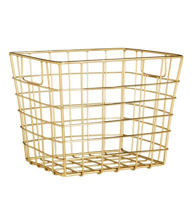 Gold. Metal wire basket with handles at the sides. Size 13x14x16 cm.