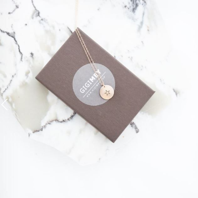 Engraved star disc necklace