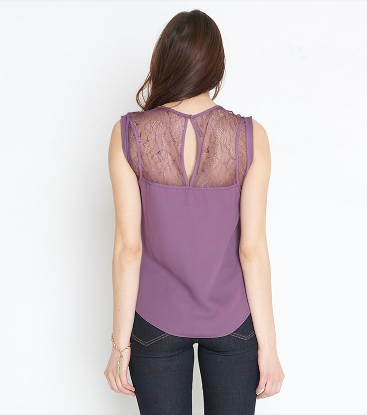 Lace is more. This heart-stopping top features delicate lace cutouts and a pretty back keyhole.