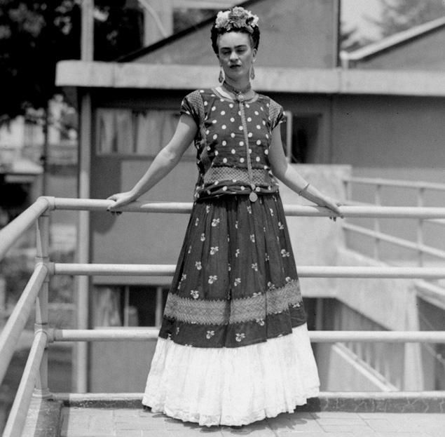 Frida Kahlo, painter and surrealist, wife of noted Mexican muralist Diego Rivera, poses at her home in Mexico City, April 14, 1939.