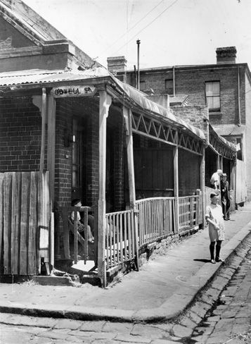 January 1953: In the 50s, Fitzroy's poor were moved to commission flats as part of the Housing Commission of Victoria's slum reclamation movement.  A boy walks down one of the streets condemned by authorities