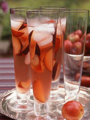 Autumn drink: white wine + cranberry apple juice + freshly sliced plums