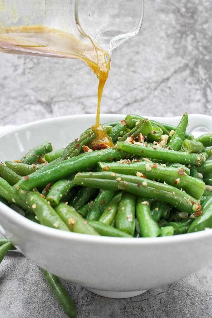 This Green Bean Salad with Almonds is made with fresh green beans, almonds, and an q Served warm or cold for an easy side dish!