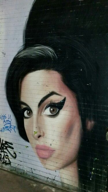 Amy Winehouse in street art at Shoreditch, London, UK