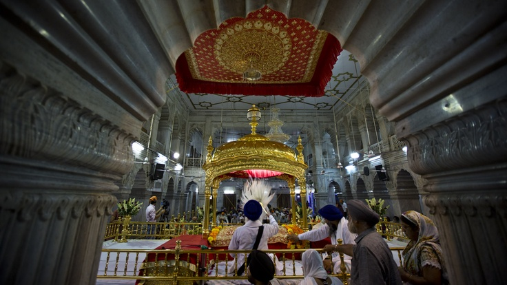 This golden throne houses the Guru Granth Sahib, the holy book of Sikhs.
