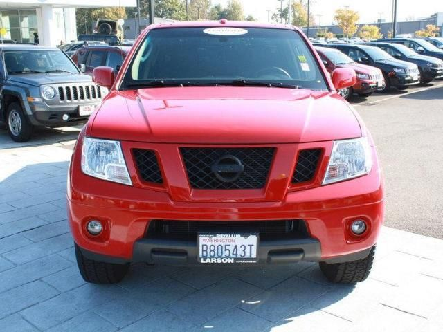 2011 Nissan Frontier PRO-4X 4x4 PRO-4X 4dr Crew Cab SWB Pickup 6M Pickup 4 Doors Red Alert for sale in Puyallup, WA Source: http://www.usedcarsgroup.com/used-nissan-frontier-for-sale