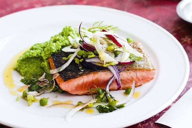 Serve crispy skin salmon on a bed of pea mash and fennel salad for a quick and presentable meal.