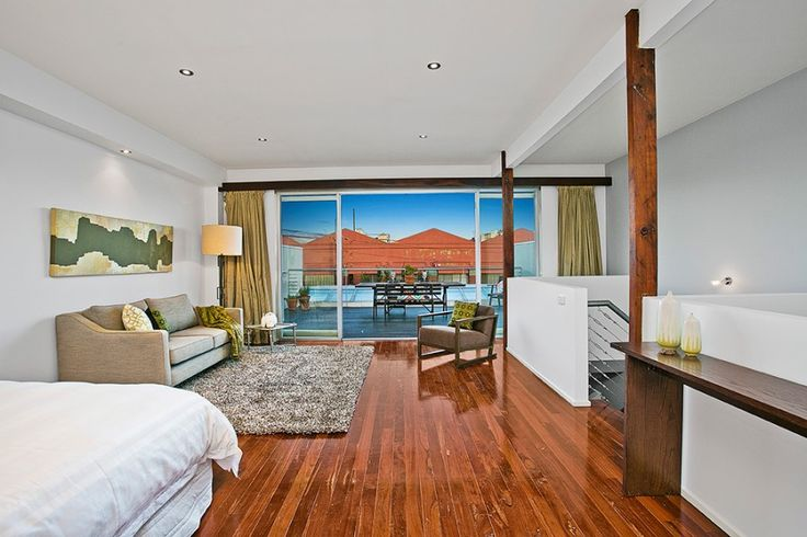 modern living room, open plan bedroom and living room perfectly fits the view. Parent retreat.