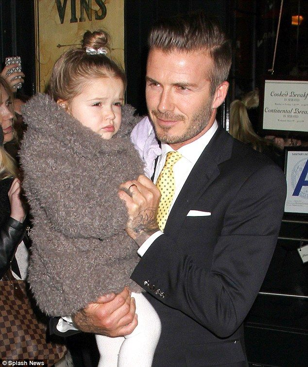 Mini fashion mogul: David Beckham has revealed his three-year-old daughter picks out his shoes when he's getting ready