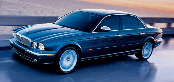 Blue Jaguar Vanden Plas, off white interior and walnut veneer.