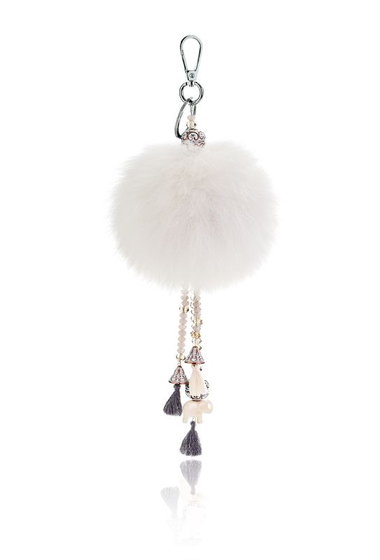 Pompon Bag Charm with 12cm white real fox fur, metal ring and clip, crystal beads and decorative elements.  Price: 42.00E