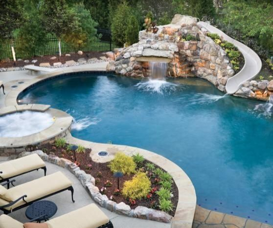 Stone pool with slide hot tub diving board future for Water pool design