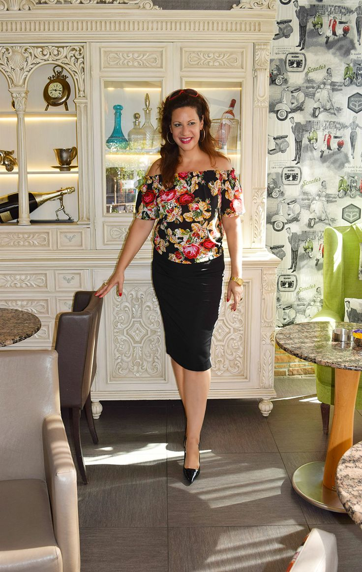 In a beautiful coffee lounge setting wearing Florals in Fall by My O.N.O Lifestyle!