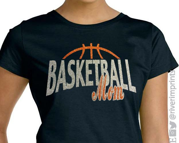 Show your BASKETBALL MOM pride in this sparkly tee shirt! This LAT - Ladies' Fine Jersey T-Shirt has a relaxed fit that's perfect for cheering on your ball player. Shown on Black with Silver & Orange
