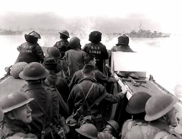 Canadian infantrymen aboard a landing craft launched from HMCS Prince Henry, off Normandy beach, France, 6 June 1944.
