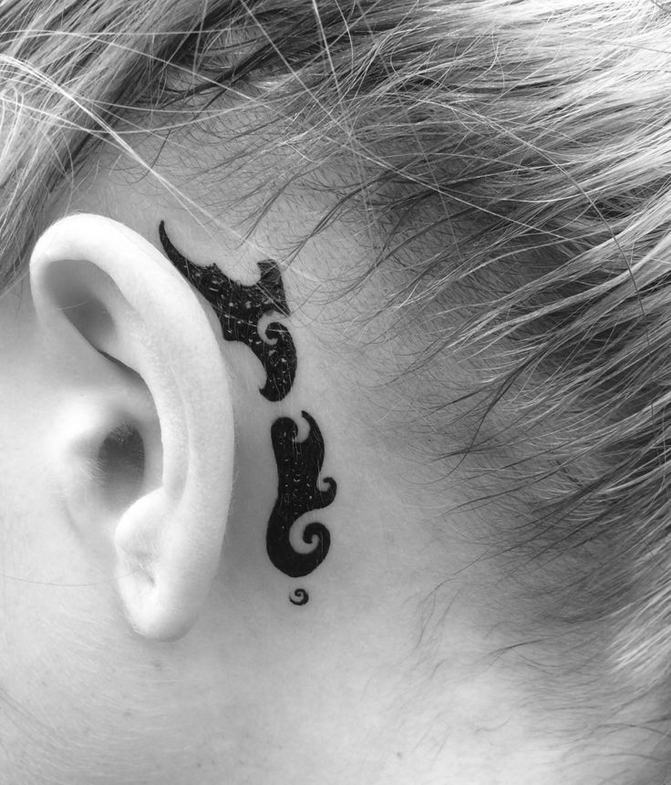 Cute behind the ear tattoo of New Zealand created with a Maori design with korus throughout it which represent new life, new beginnings, and harmony
