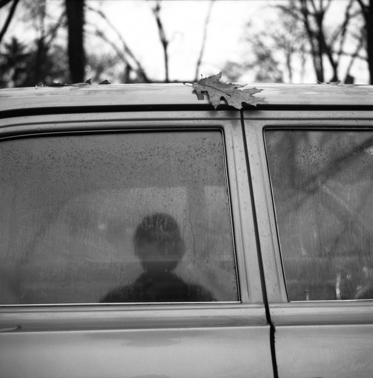 rgogopin: Vivian Maier, Self-Portrait (Car Window Reflection with Leaf), ca. 1967