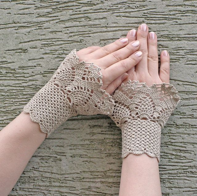 Crocheted lacy cuffs by hypericumfragile, via Flickr