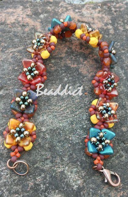 """June"" bracelet. Designed  by Olga Cojocru. Beaded by Beaddict. Seed beads, firepolished beads, two-hole triangle beads."
