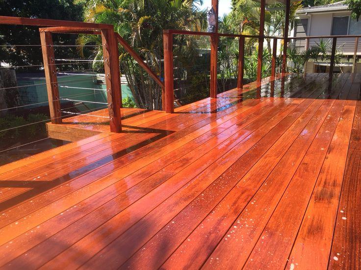 Merbau decking raised with Merbau posts and stainless steel balustrade get wire.