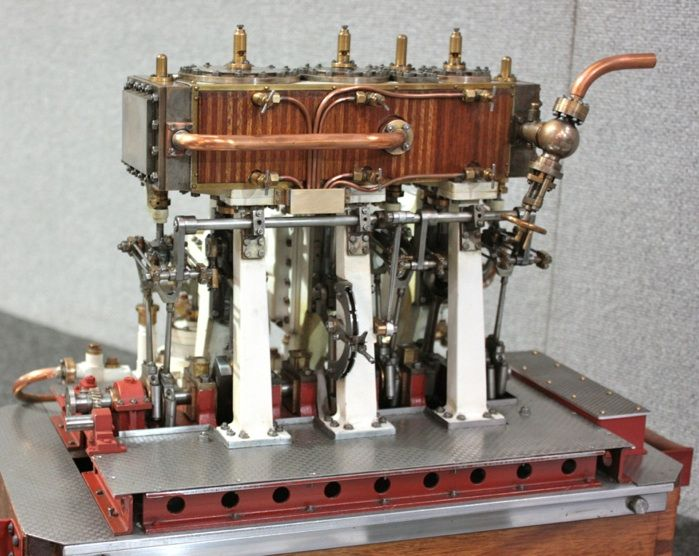 This is a model of a Vertical Triple Expansion Steam Engine. This type of engine was used in ships from 1881 through the end of World War II. A triple expansion engine is a compound engine that expands the steam in three stages, that is, an engine which has cylinders operating sequentially at three different pressures.