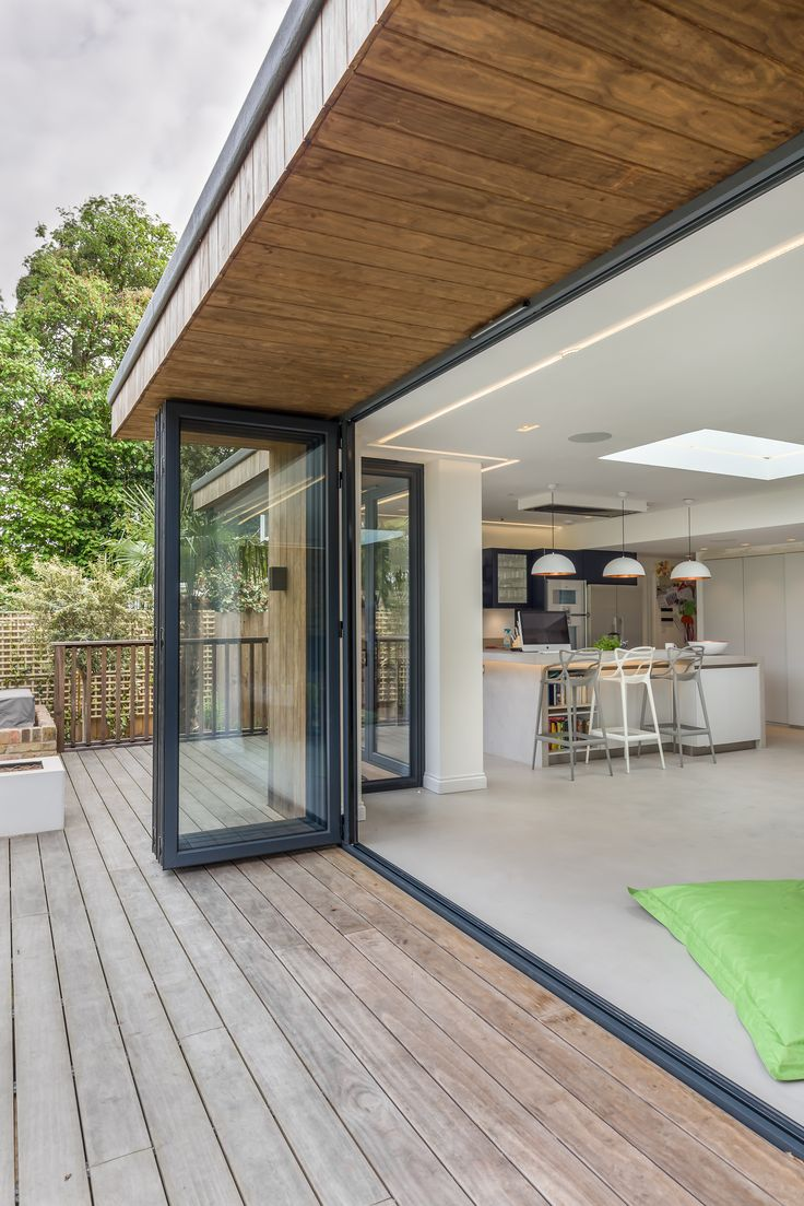 Bi-fold doors | inside outside | level threshold | timber decking | timber clad roof overhang | open plan | contemporary architecture | three eleven design | brighton architects |