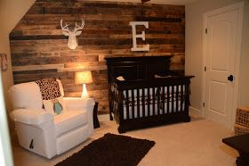 Rustic baby room. Love the wood accent wall!