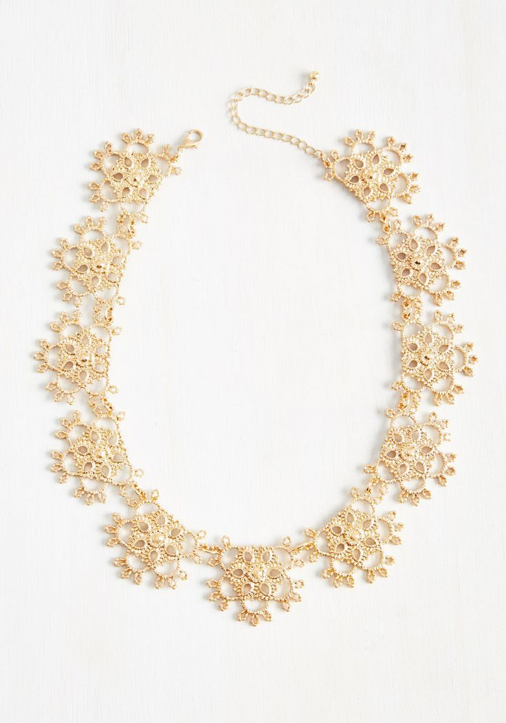 Shoot for the moon, and sparkle in this gold statement necklace on your way toward achieving those goals! Starring a series of filigree pendants, this eye-catching piece gives off a hopeful glimmer.