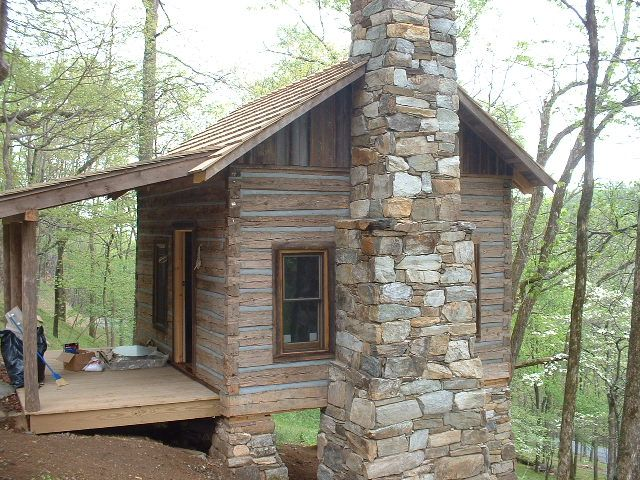 Old log cabin stone fireplace the completed cabin with for Log and stone house