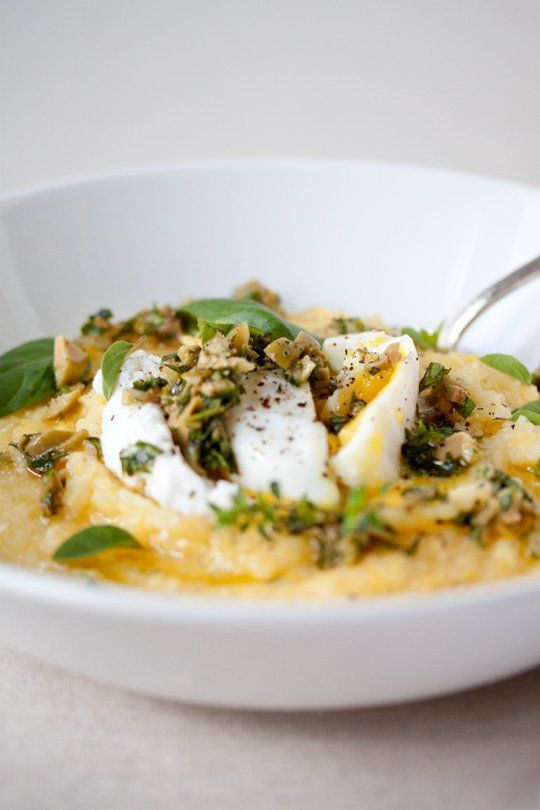poached eggs over polenta with olive herb pesto