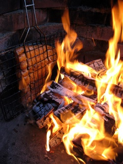 "A raw fillet of rainbow trout cooked on a campfire. The Finnish name of the meal is Loimulohi, ""blazed salmon""."