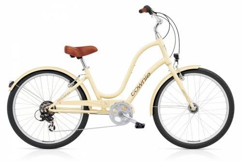 Townie original 7D EQ Vanilla Ladies - Bysykkel med lys og 7 gir  Syklene i Townie serien fra Electra er en moderne bysykkel som gjør sykkelturenelegant og komfortabel. Her er det snakk om å sykle med stil, du sitter høyreist og meget elegant! Selv om sykkelen er solid, er den lettere enn den tradisjonelle damesykkelen da den har aluminiumsramme.  EQ versjoner har ferdig montert LED forlys og baklys,som drives av innebygget dynamo.  Town...