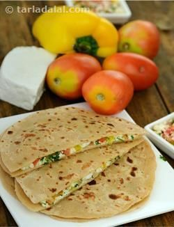 Paneer tamatar paratha, is an interesting variation of the paneer paratha with the zest and tang of tomatoes. Minimum oil has been used to knead the dough and cook tp parathas,making it weight-watchers delight.