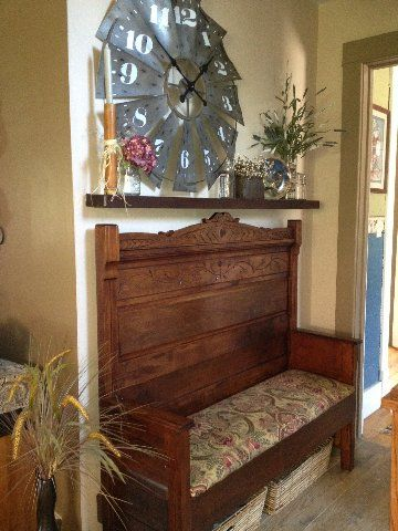 This is an old antique headboard made into a bench.  The arms are the foot-board cut in two pieces.