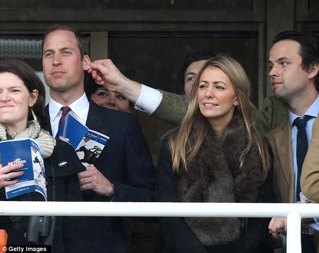 Ear, ear! The Duke of Cambridge has his ear pulled by a pal at the races today.  March 15, 2013