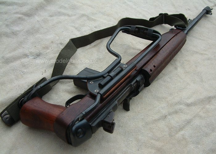 M1A1 Paratrooper Carbine.  cal .30 carbine. Over 6 million M-1 carbines were made for the U.S. Army until 1945. Not to be confused with the M-1 rifle. The carbine is much lighter and shorter, and uses different, lower power ammunition. 15 and later 30-round magazines. This is the paratroop version, with folding stock.