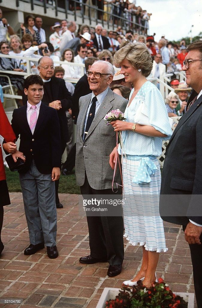 Princess Diana With Armand Hammer At Palm Beach Polo Club, Florida In 1985. The Princess Is Wearing A Dress Designed By Kanga